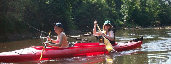 2 women kayaking at Enfield's annual fishing creek paddle