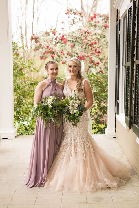Bride and bridesmaid on the back porch of Bellamy Manor and Gardens
